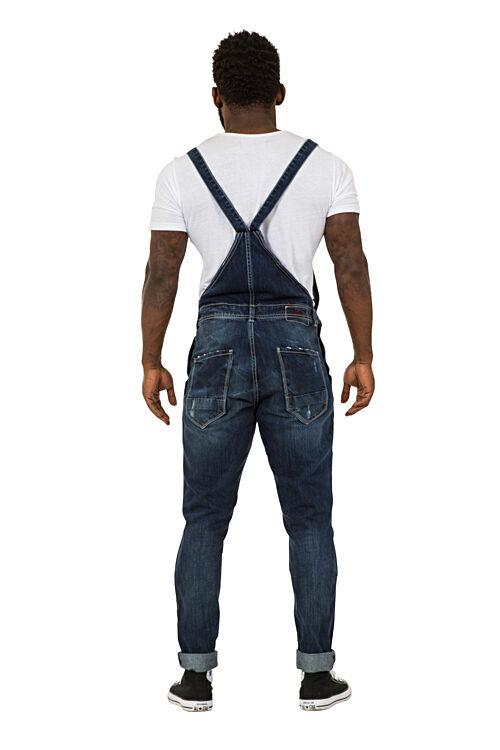 Full rear pose wearing 'Alan' brand Mens Destroyed Denim Dungarees, showing rear pockets and cross straps.