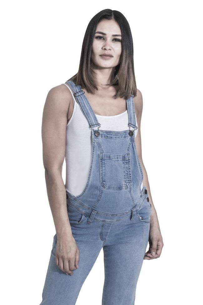 Two-thirds frontal pose showing top half of Grace-style maternity dungarees, focussing on belt loops, front and bib pockets.