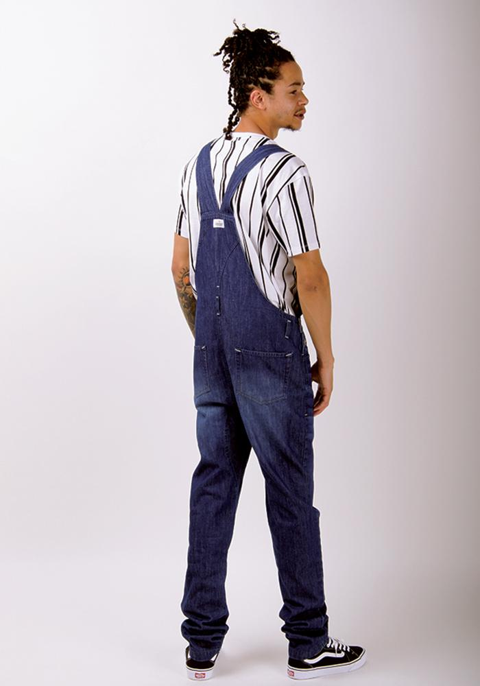 Full back view of 'Jesse' brand slim-fit darkwash dungaree with view of cross back straps, back pockets and belt loops.