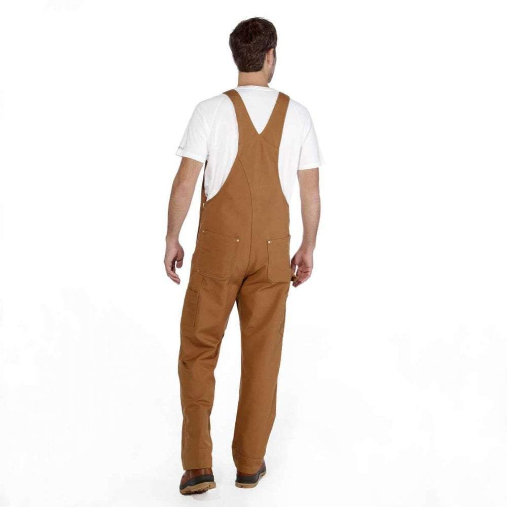 Rear pose wearing brown unlined bib overalls.