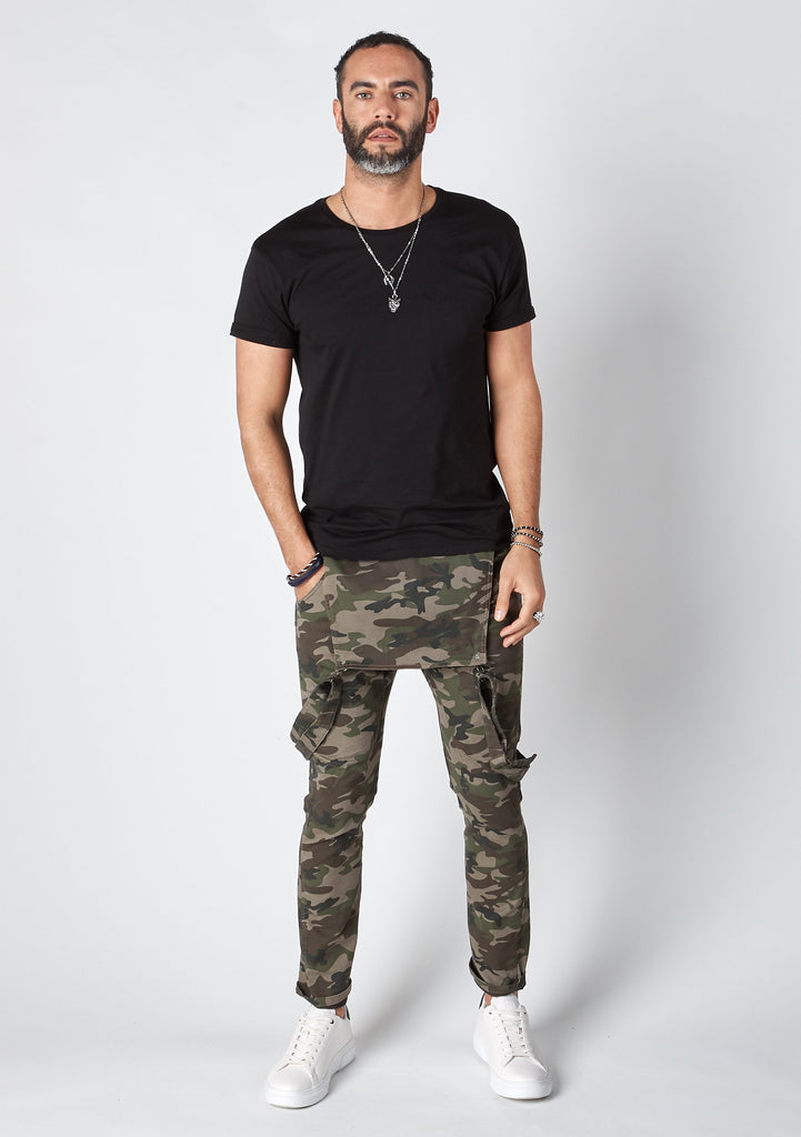 Frontal pose with bib down wearing camouflage, 'Burton' brand skinny fit dungarees from Dungarees Online.