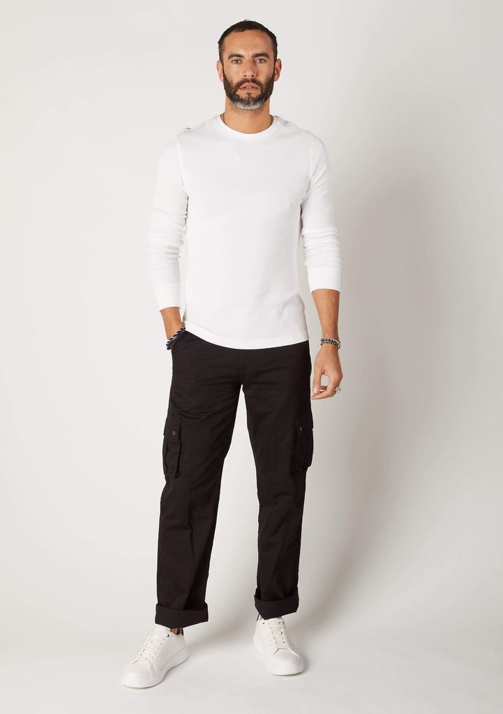 Front view of men's organic cotton loose fit cargo trousers from Dungarees Online, with hand in front-right pocket.