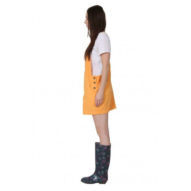 Full-length side view of above-the-knee, casual dungaree dress.