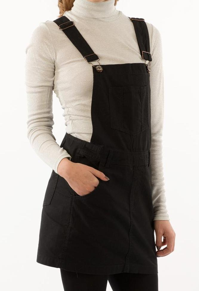 Focus on front of Cicely black bib-overall dress, cropping head and legs.