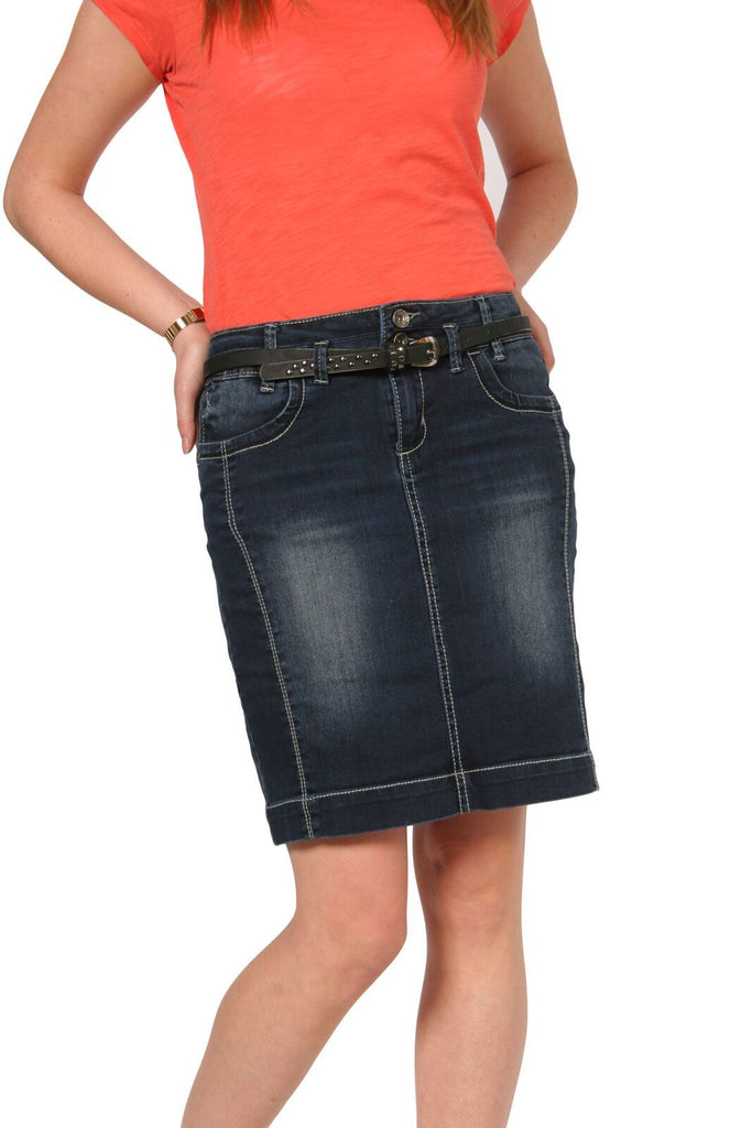 Mid-view, leaning on left hip wearing stylish cotton-mix denim, stretchy skirt from Dungarees Online with belt.