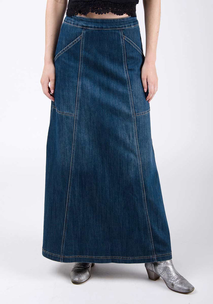 Half-front pose focussing on deep utility pockets and A-line silhouette of maxi denim skirt.
