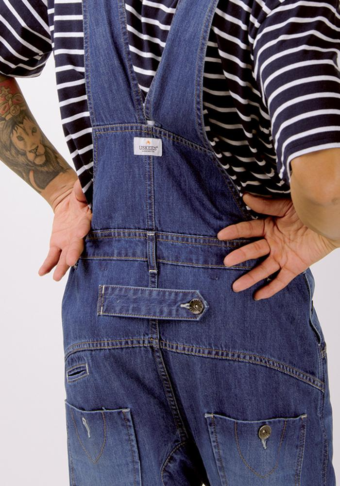 Zoomed in on rear detailing of 'Danny' brand men's light wash relaxed fit organic bib overalls.