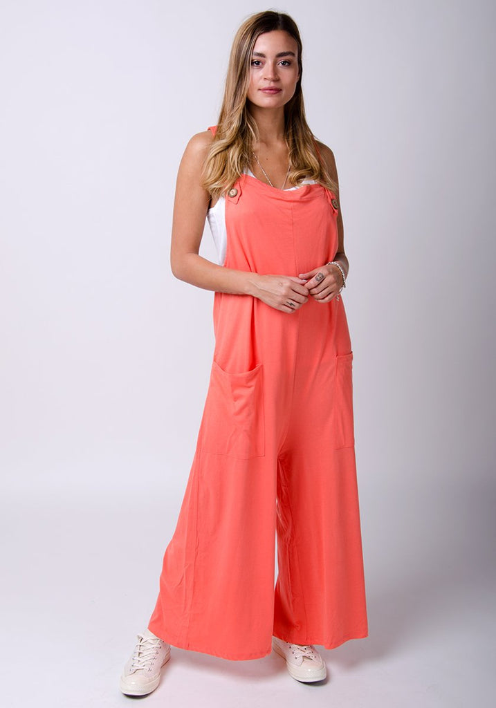 Frontal, full-length model wearing our coral, cotton jersey, wide-leg dungaree.
