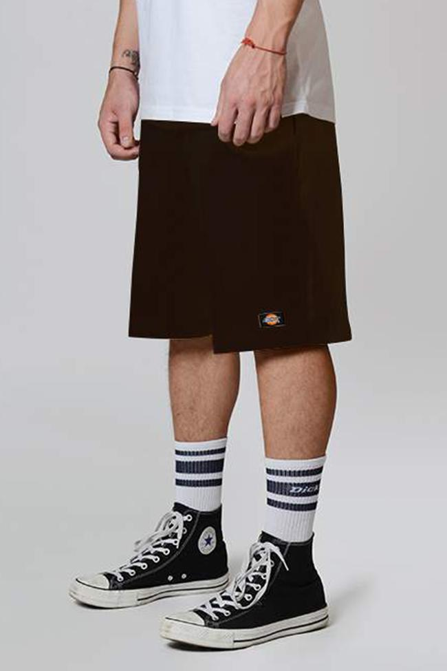 Angled side-view of brown Dickies multi-pocket work short with permanent front crease.