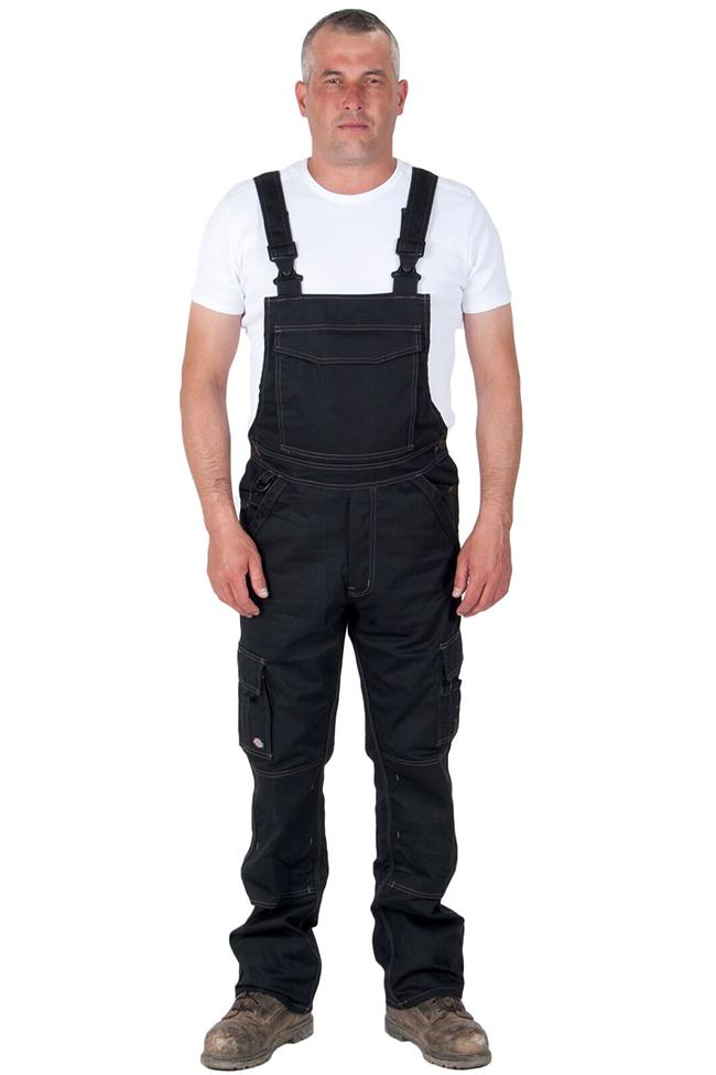 Full frontal view of Dickies black work dungarees, detailing pockets, zip fly and polyester-cotton mix material.
