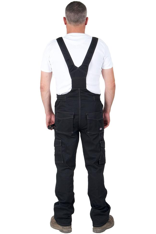 Full rear view of Dickies dark work dungarees, detailing back pockets and elastic back waist.