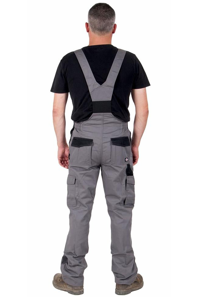 Full rear view of Dickies grey work dungarees, detailing back pockets and elastic back waist.