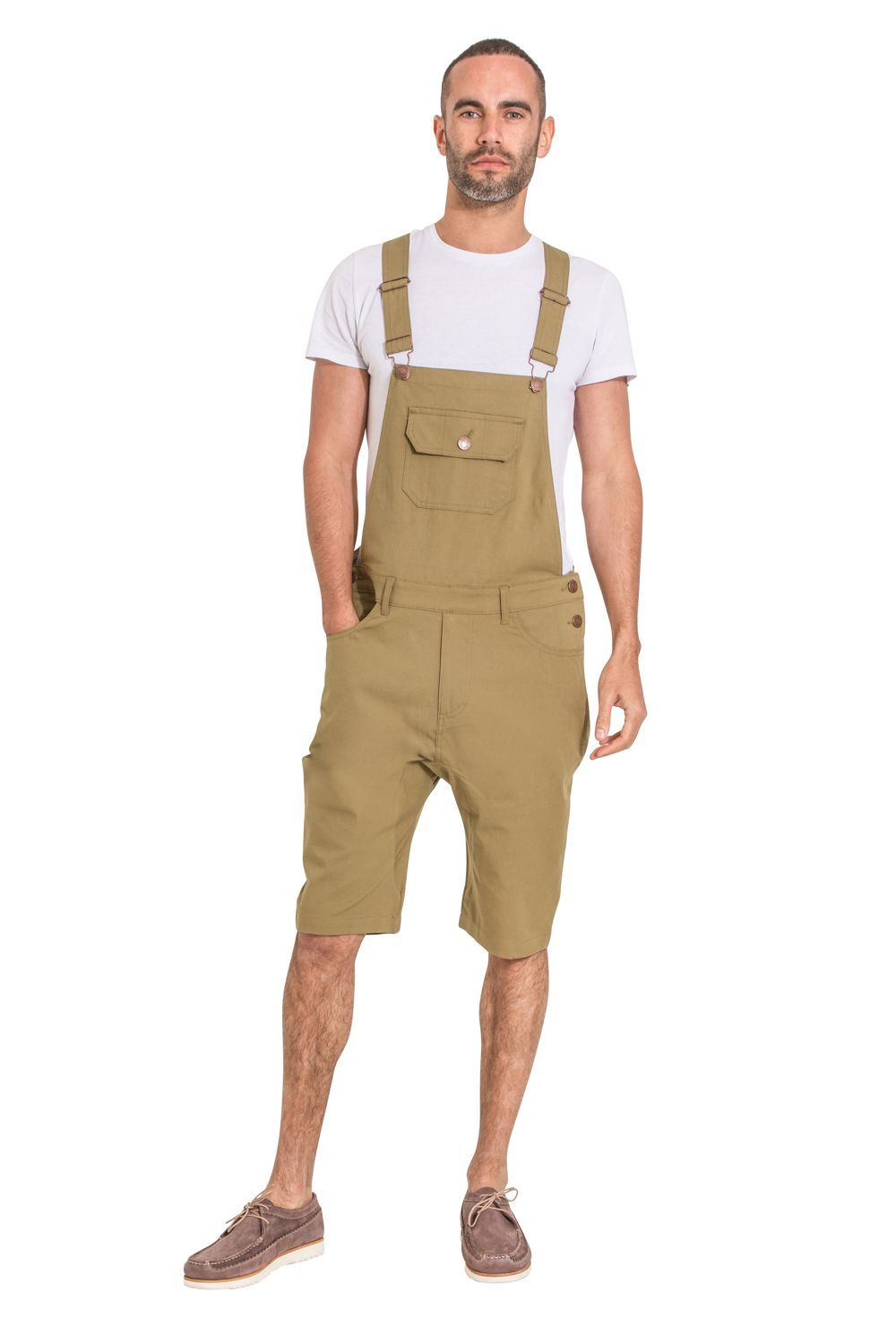 Full frontal pose looking straight ahead, wearing slim-fit, olive cotton bib-overall shorts, styled with white t-shirt and brown suede shoes.
