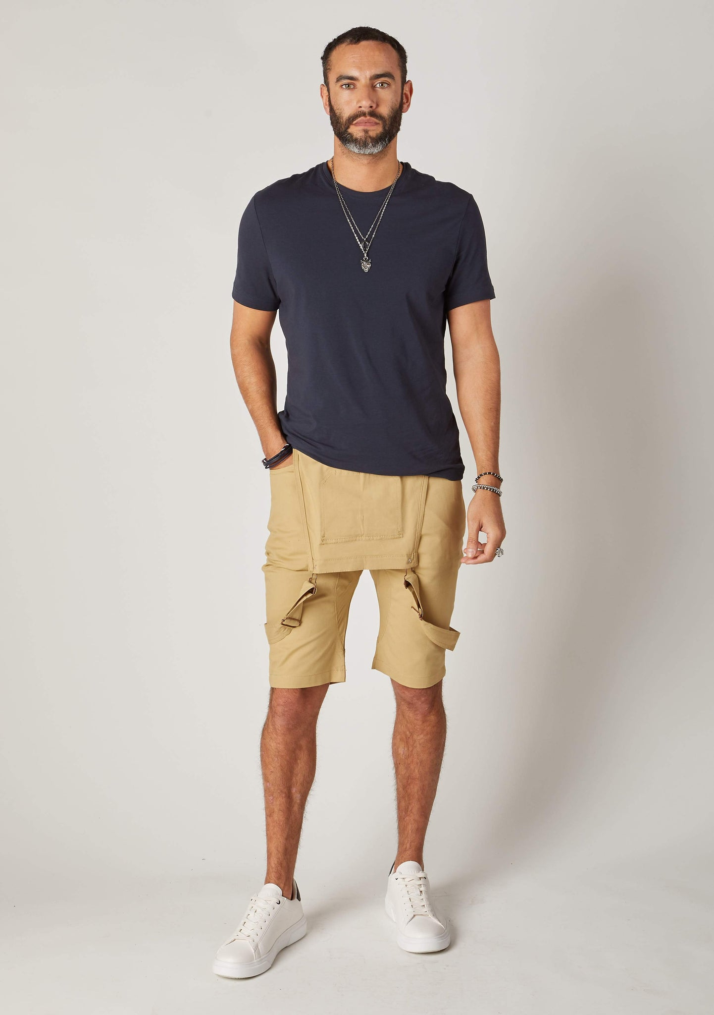 Full frontal bib-down view of slim-fit, khaki cotton bib-overall shorts from Dungarees Online, revealing dark grey t-shirt.