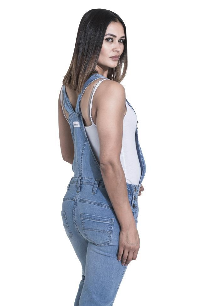 Rear-side pose showing back pockets and detailing of mums-to-be overalls from Dungarees Online.
