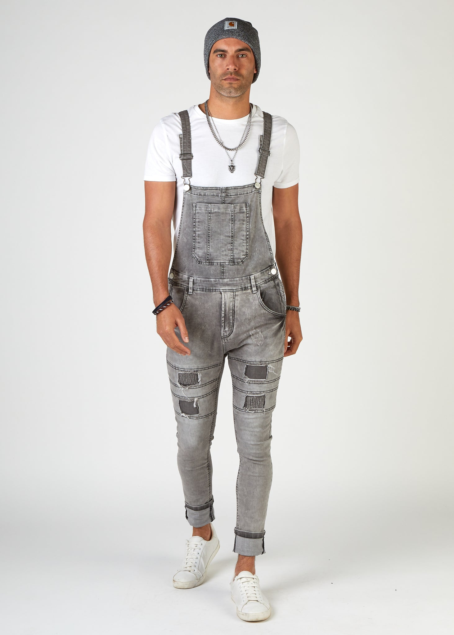 Walking front view of Failsworth super skinny dungarees with legs turned up slightly