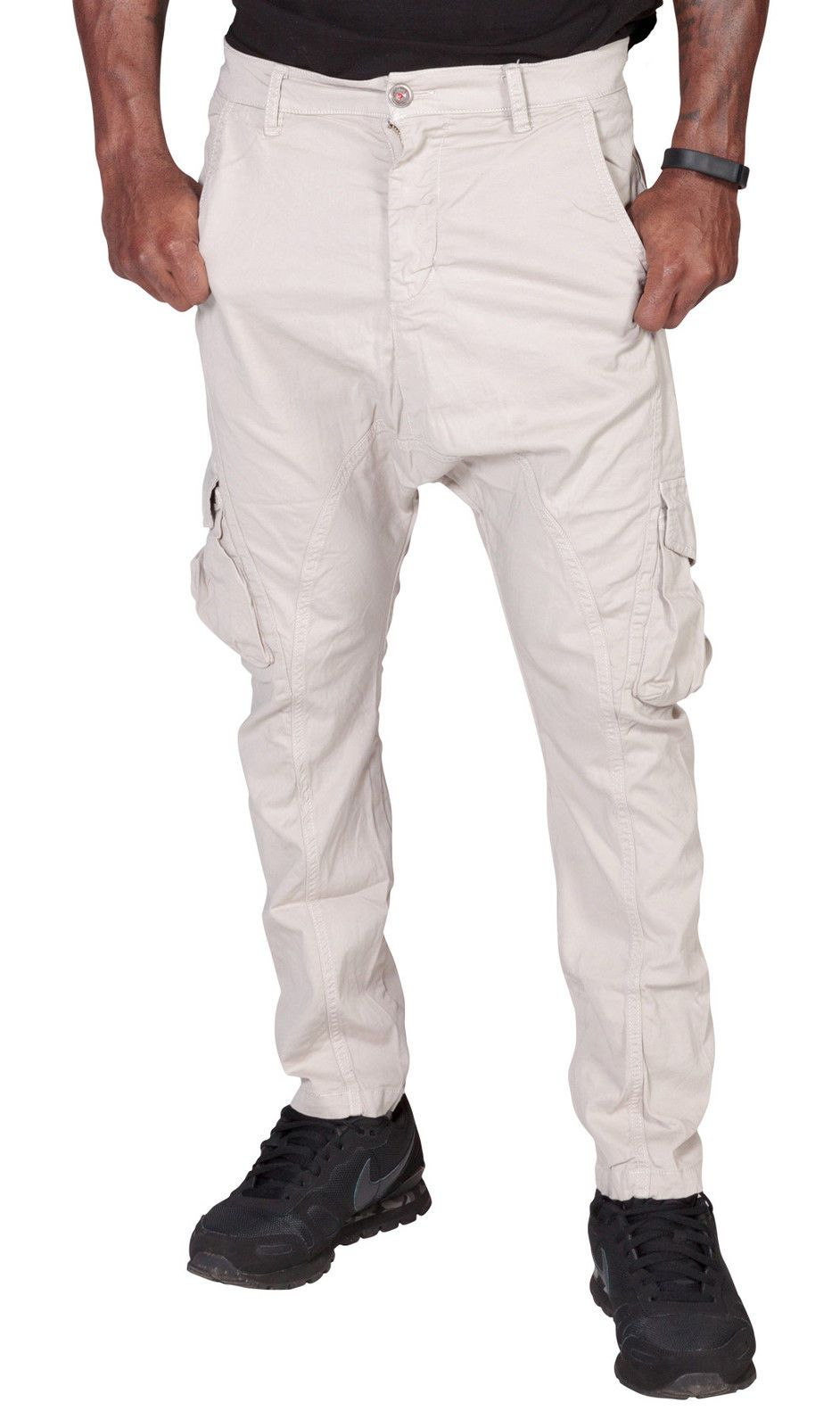 Close-up frontal of 'Finley' style, casual cotton mix cargo trousers in stone, with view of front pockets, belt loops and drop crotch styling.