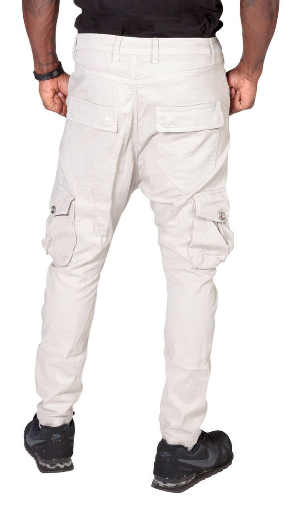 Close-up back view of 'Finley' style, casual cotton mix cargo trousers in stone, with view of multiple pockets, belt loops and tapered silhouette.