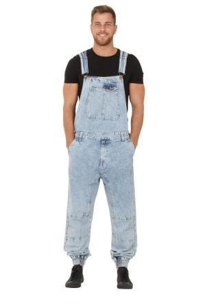 Model with hands in front pockets of pale blue, elasticated ankle dungarees.