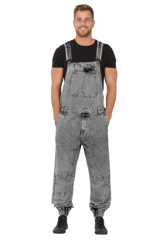 Model facing ahead, with hands in front pockets of black, elasticated ankle dungarees.