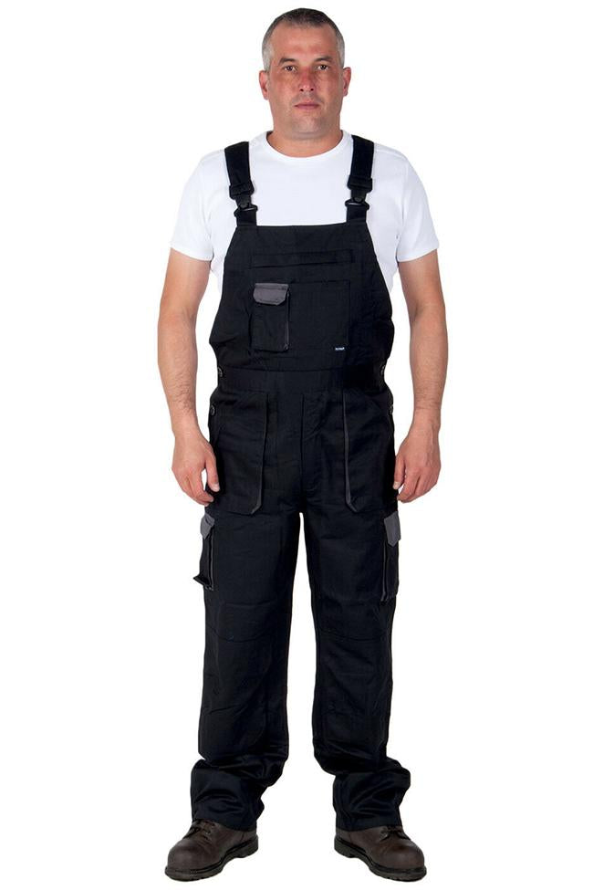 Full-frontal pose wearing Portwest Texo Contrast work dungarees with view of zip fly, knee pad pockets and various bib pockets.