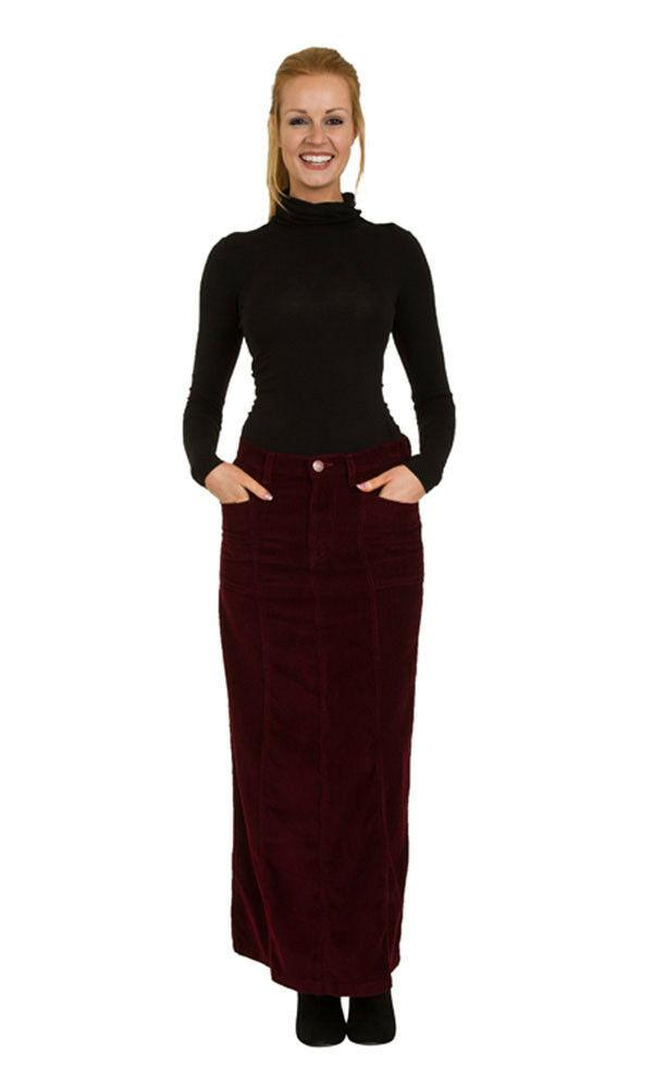 Front view of full-length burgundy corduroy skirt with hands in front pockets.