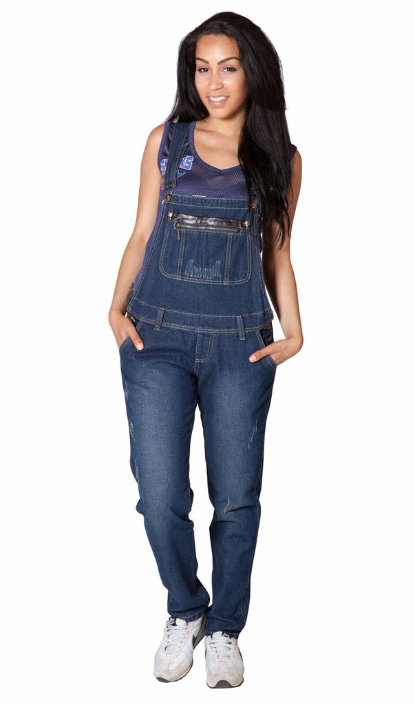 Full frontal pose with hands in front pockets, wearing women's denim bib-overalls from Dungarees Online.
