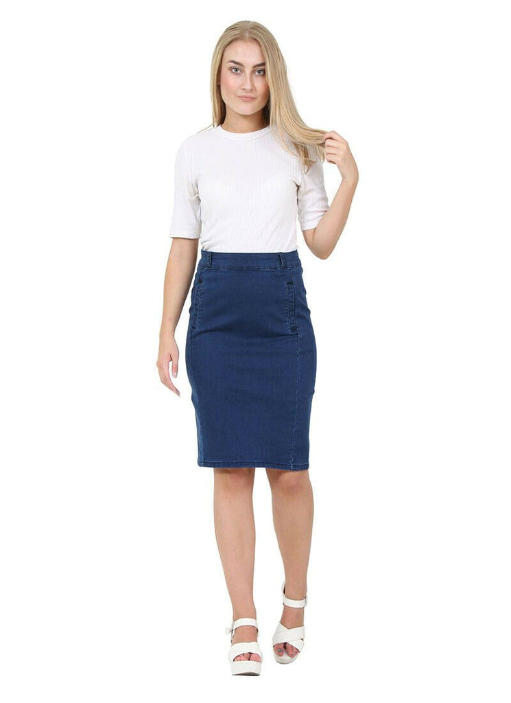 Full frontal walking pose, wearing streamlined, mid-dark blue denim midi skirt with mock front pockets from Dungarees Online.