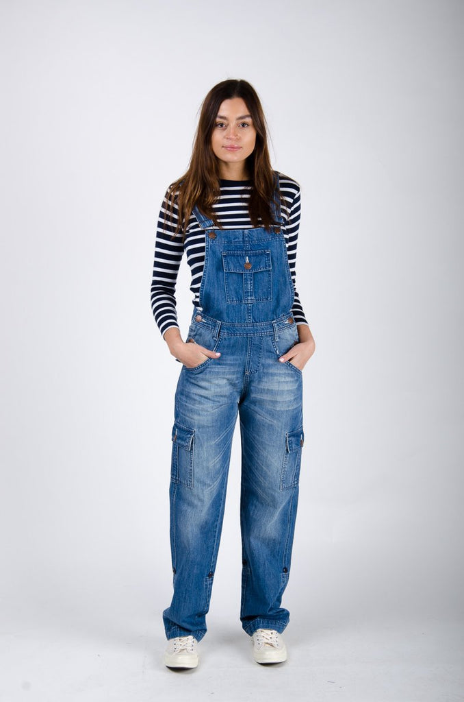 Full frontal with hands in both front pockets, wearing casual and roomy dungaree from Dungarees Online.
