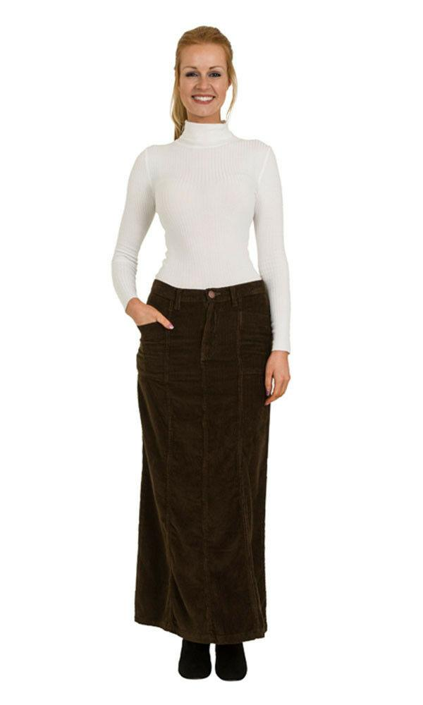 Front view of full-length olive corduroy skirt with right hand in front pocket.