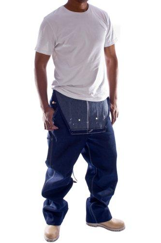 Frontal pose with thumbs in front pockets, wearing Carhartt R08 reinforced indigo denim dungarees with bib down.