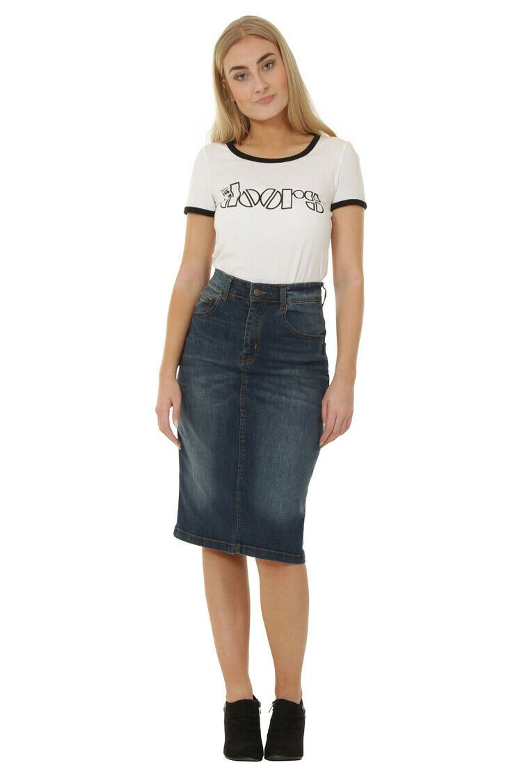 Full frontal wearing classic mid-length stretch denim skirt with clear view of button closure and belt loops.