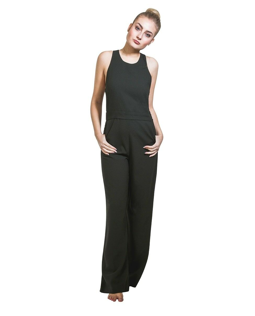 Full frontal pose with thumbs in front pockets, wearing women's polyester, high waisted, wide leg trouser jumpsuit from Dungarees Online.