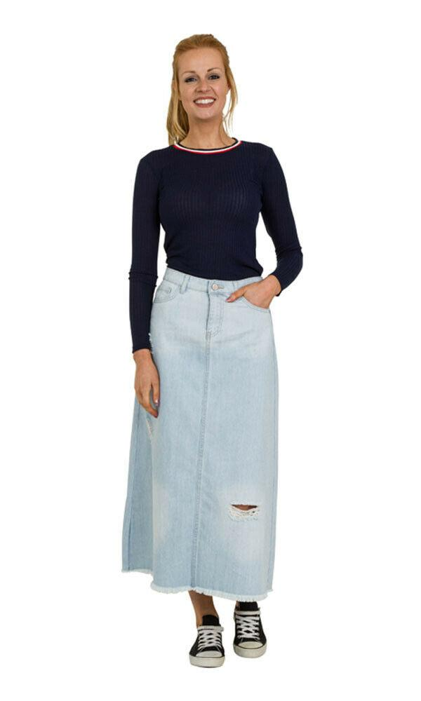 Back view of light-coloured denim maxi skirt with raw hem detailing.