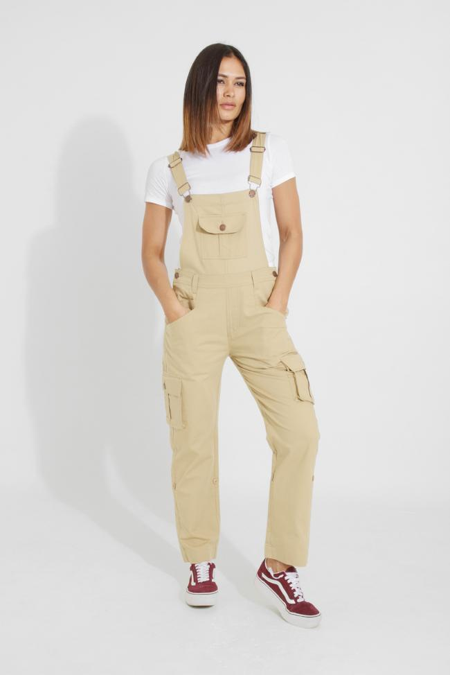 Full frontal with hands in both front pockets and weight on right hip, wearing casual, loose fit pale-khaki dungaree from Dungarees Online.