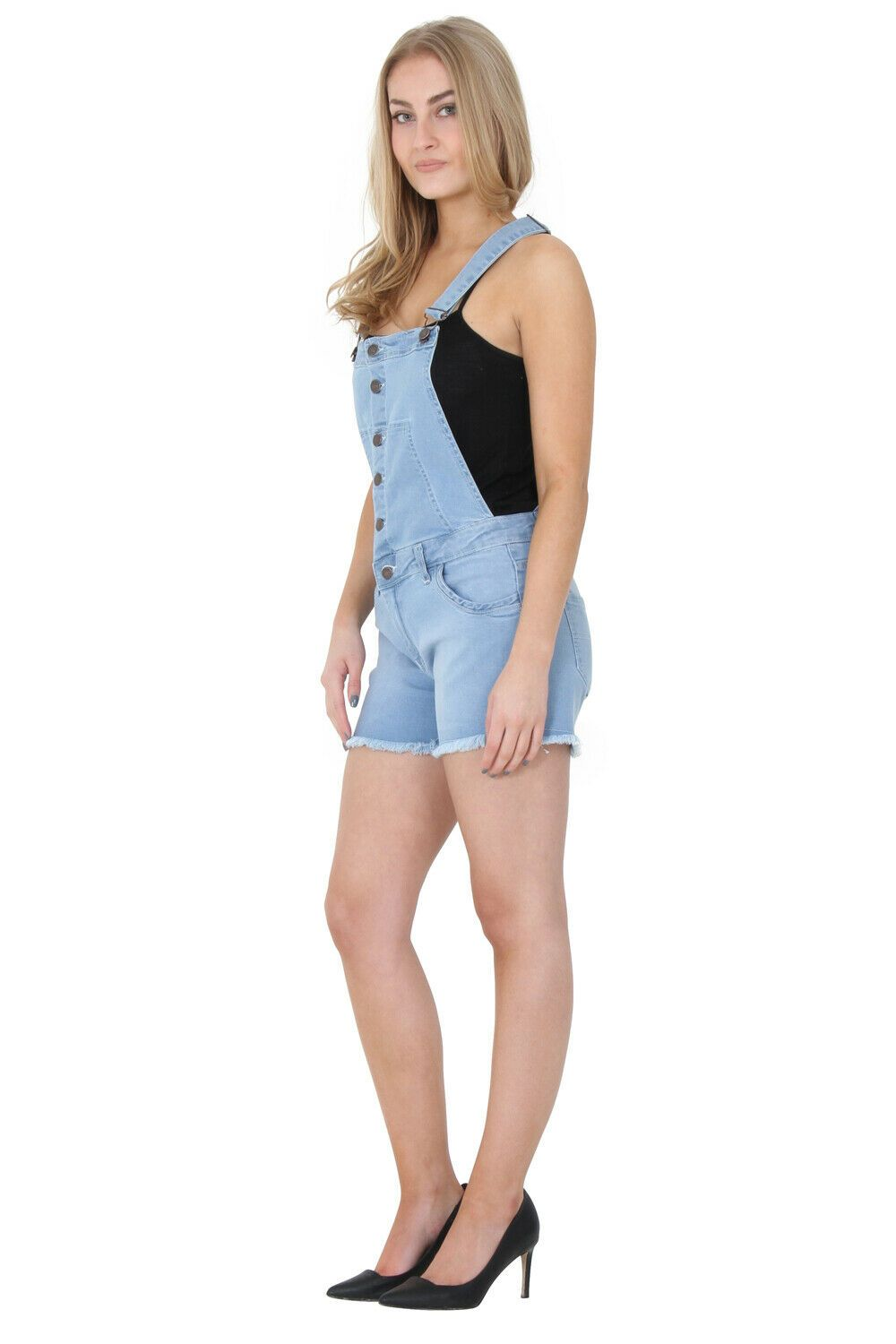 Angled front view of stretchy cotton-mix light denim dungaree shorts with view of front pockets and left adjustable strap.