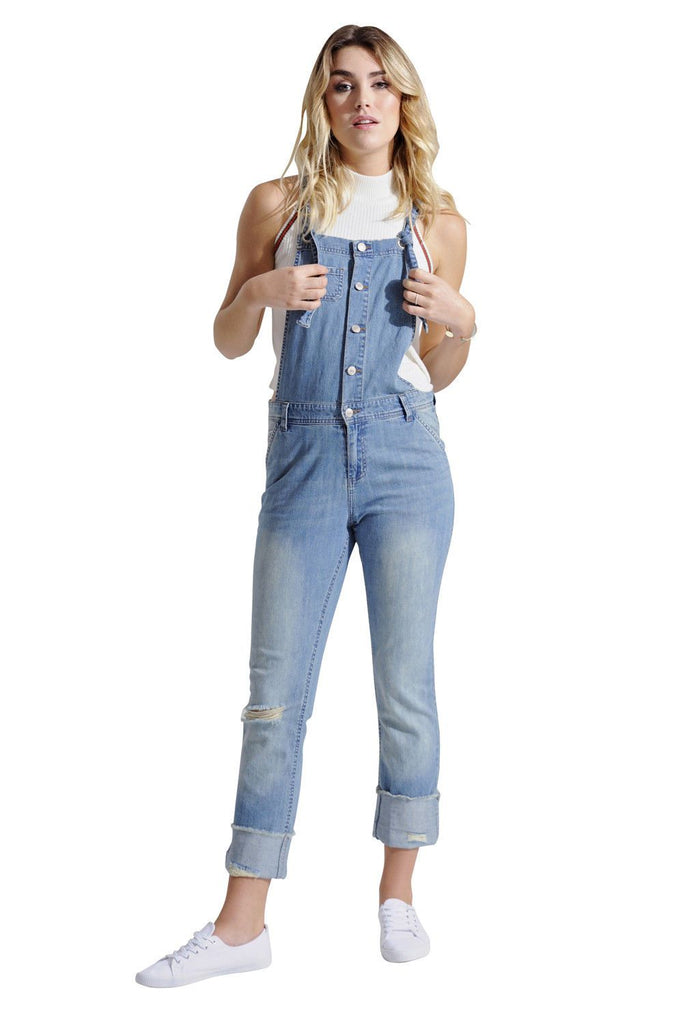 Full-length frontal of buttonfront slim fit distressed lightweight dungarees with view of adjustable tie straps.