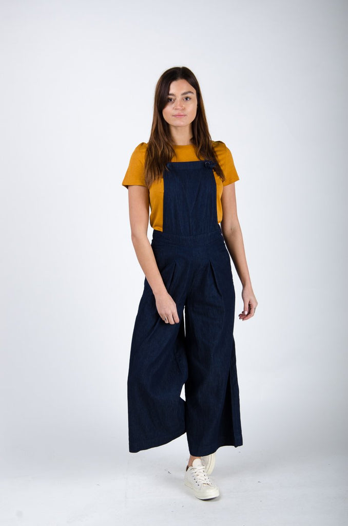 Full frontal walking pose wearing 'Bluebell' brand culotte dungarees from Dungarees Online.