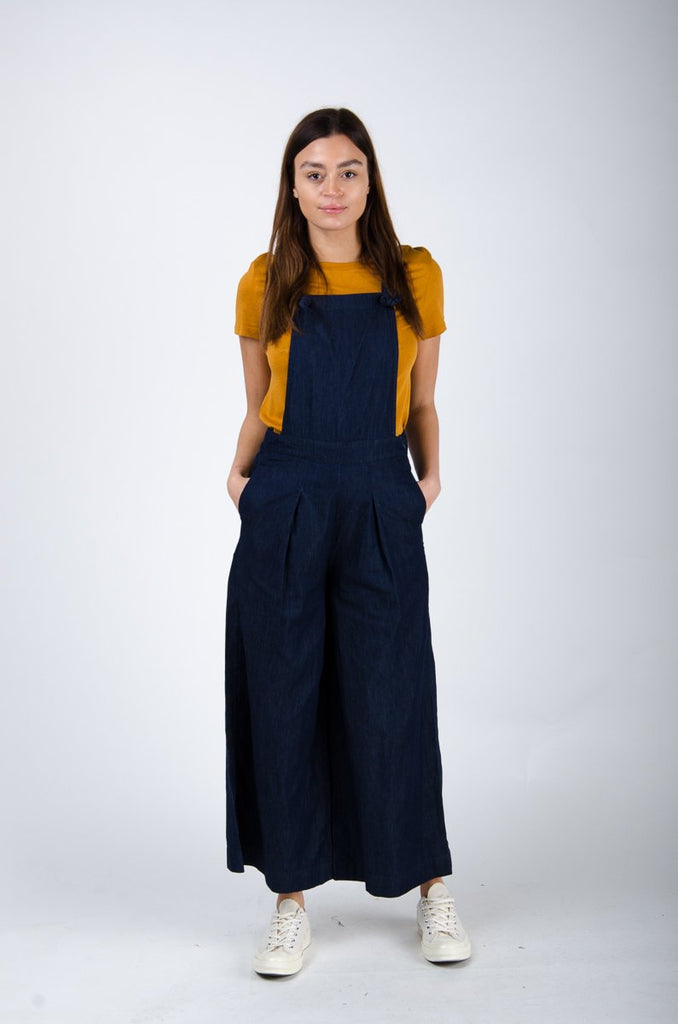 Full frontal pose with hands in side pockets, wearing 'Bluebell' brand culotte dungarees from Dungarees Online.