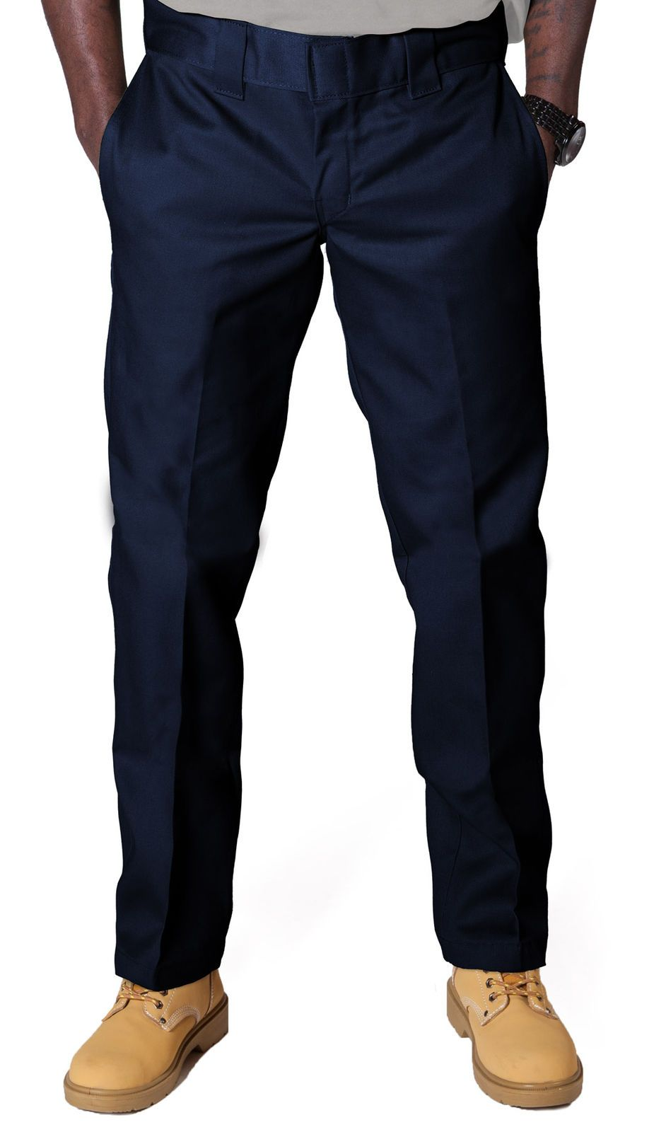 Closer front view of Dickies slim fit 873 work pant in navy-blue with hands in front pockets, showing permanent crease, twill fabric and tunnel belt loops.