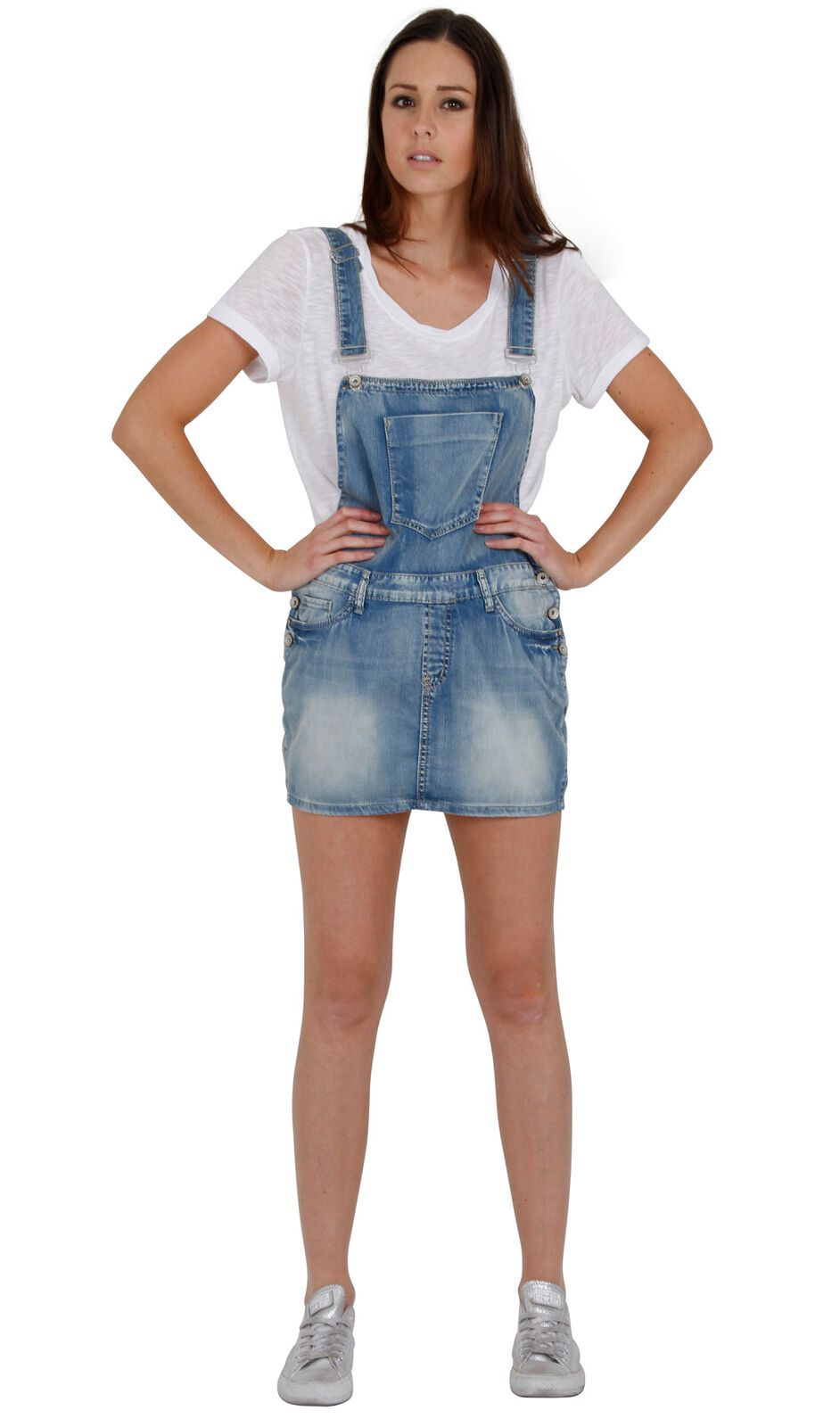 Full-length front view of stylish, ultra-short, faded blue denim dress from Dungarees Online. Model with hands on hips.