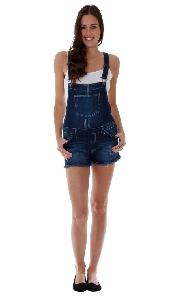 Top-half rear of soft, stretchy mid-weight denim bib-overall shorts from Dungarees Online with thumbs in front pockets and view of frayed hems and abrasion detail.