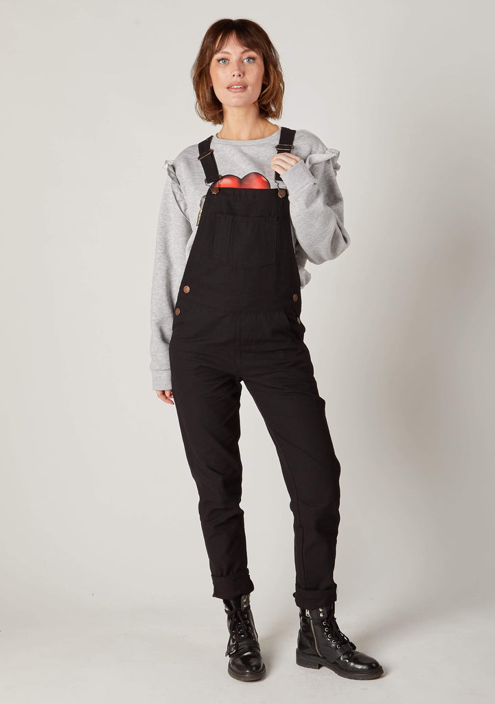 Full frontal Carrot fit black dungarees showing front and bib pockets.