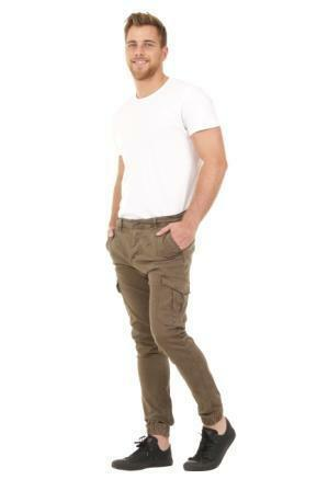 Full angled front-side view of green cotton mix combat trousers with hands in front pockets and view of cargo pockets.