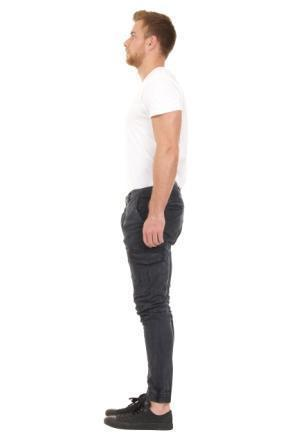 Full side view of 'Gareth' style, casual cotton mix cargo trousers in navy-blue with view of elasticated ankle.