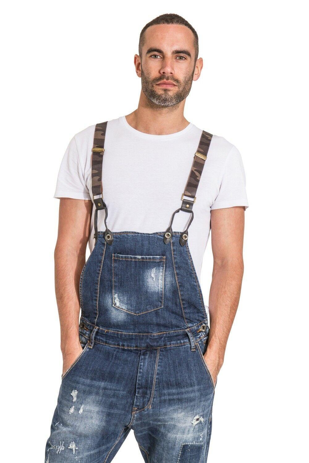 Top-half view of men's 'Lazlo' dungarees with abrasions with hands in front pockets. Clear view of detachable braces, Side button fastening and zip fly.