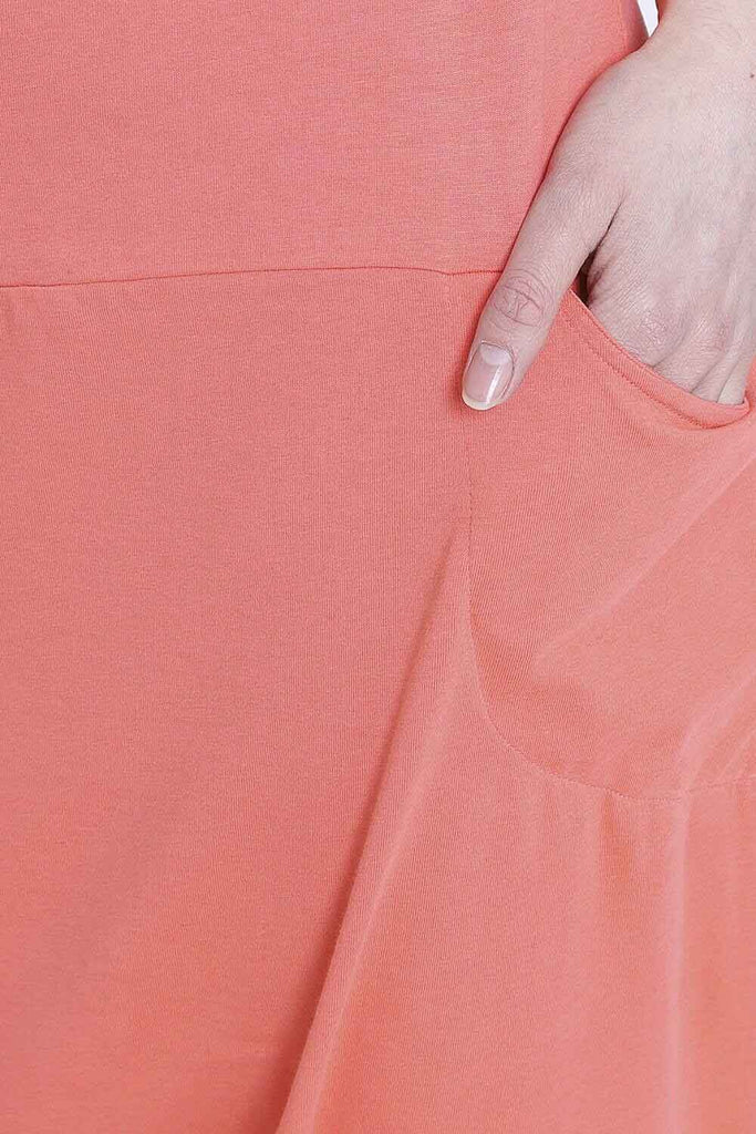 Close up of front pocket on Jools-style coral cotton jersey fabric.
