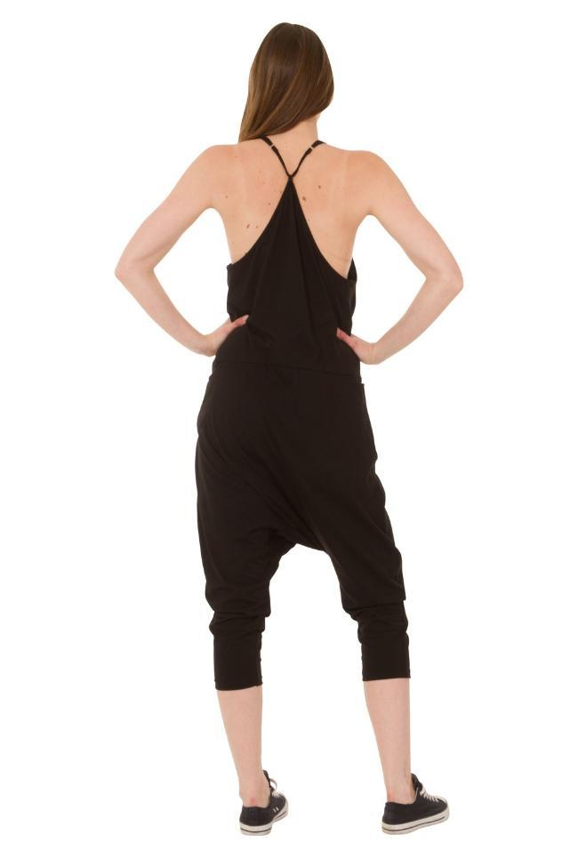 Full rear pose showing adjustable straps and comfortable shape of jersey jumpsuit.