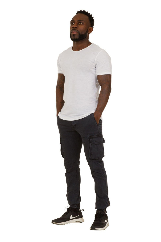 Full angled front-side view of navy-blue slight-stretch cotton mix combat trousers with view of cargo pockets and ankle zip.