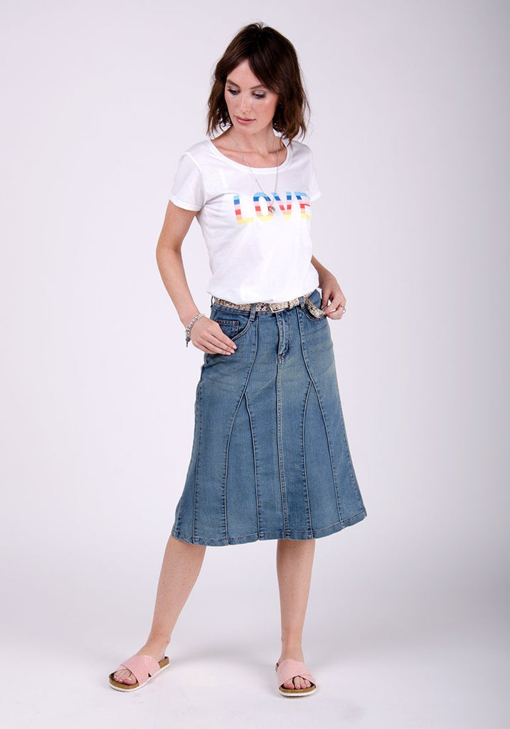 Full frontal pose wearing Dungarees Online's Kim style midwash flared skirt.